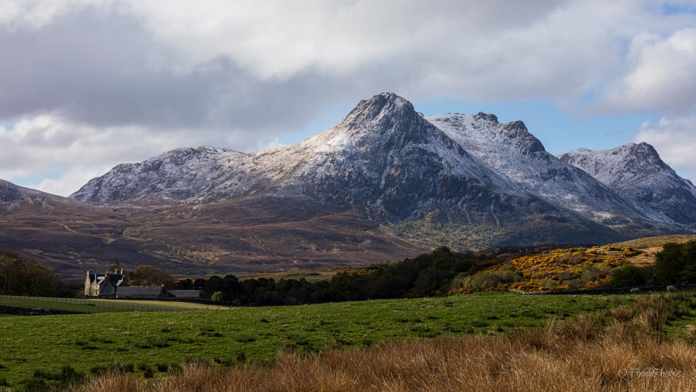 Ben Loyal covered by light snow, farm in Ribigill